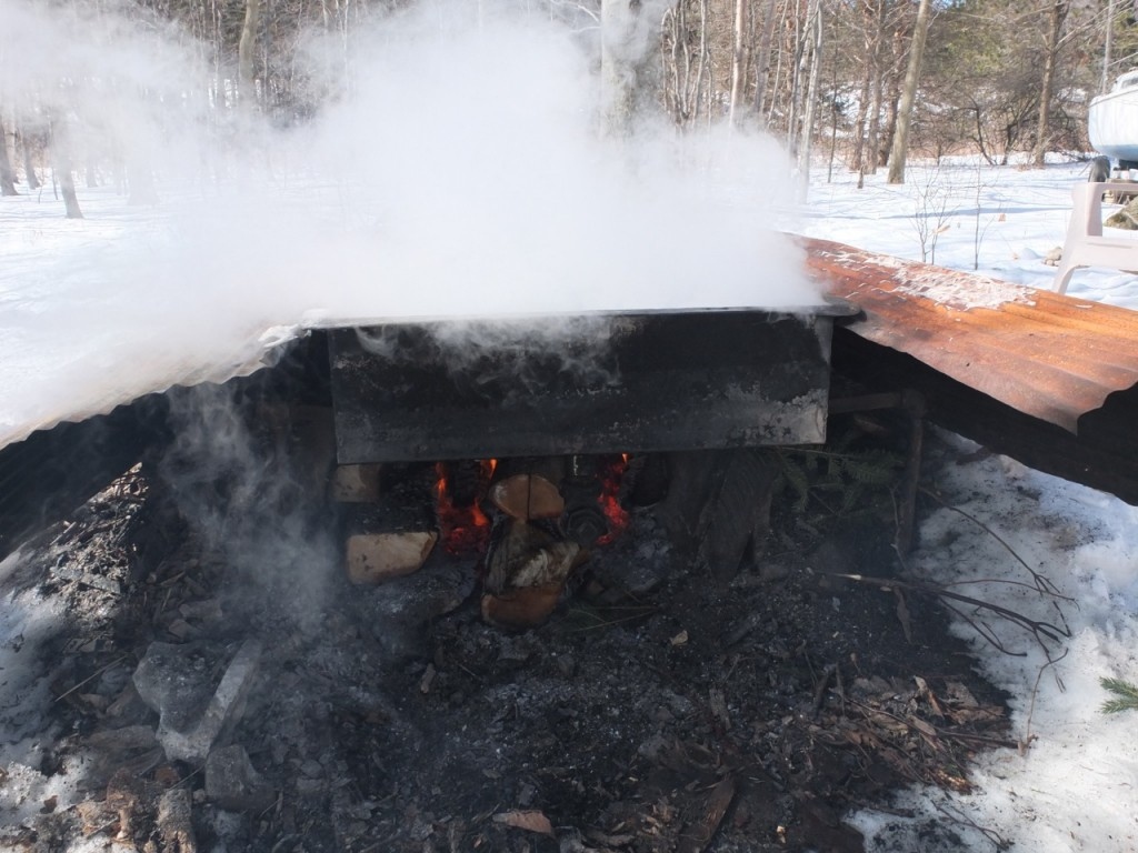 Maple sugaring time - the fire must be stoked often under the evaporator
