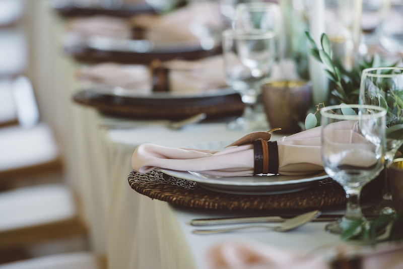 Rattan Chargers and Leather Napkin Rings Epicure Catering and Cherry Basket Farm Wedding