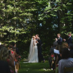 Bride and Groom First Kiss | Farm to Table Wedding | Epicure Catering and Cherry Basket Farm | Northern Michigan Barn Wedding Venue Omena MI